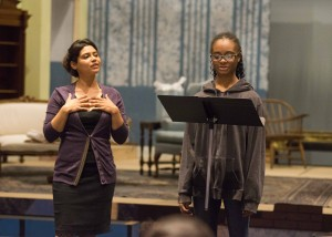Opera singer Alexa Lokensgard '99 helps a student thespian with her delivery.